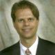 Dr. John E. Levis